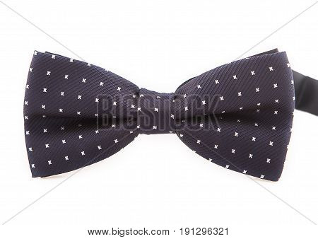 formal black bow tie in white polka dots on white background.