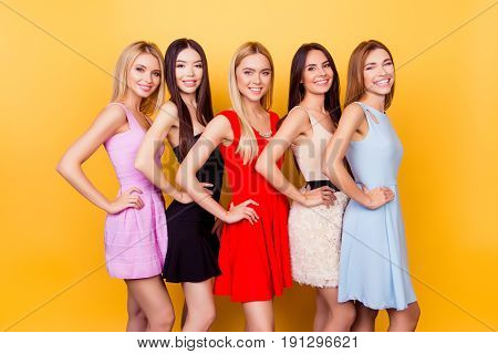 Diversity Of Beauty And Ethnicity. Excited Girlfriends In Colorful Short Cocktail Dresses Are Ready