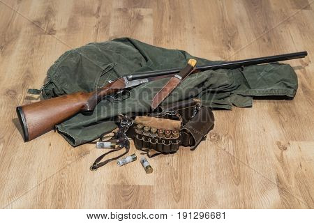 Old Double-barreled Shotgun, Old Green Jacket, Knife In Scabbard, Amunition Belt And Cartridges For