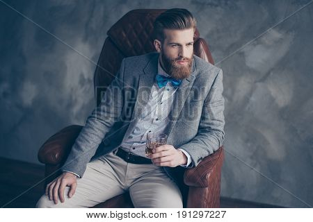 Successful Young Red Bearded Elegant Businessman In Suit With Perfect Hairstyle Is Drinking Whiskey