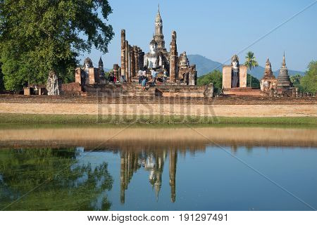 SUKHOTHAI, THAILAND - DECEMBER 29, 2016: Tourists on the ruins of the ancient Buddhist temple Wat Mahathat. Historical Park of Sukhothai