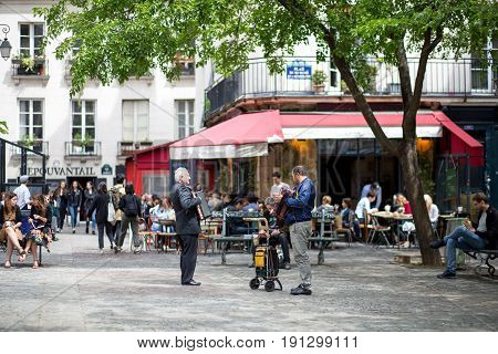 Paris, France - May 11, 2017: Street musicians performing on a square
