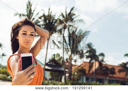 Cute Girl Make Selfie On Tropical Beach.