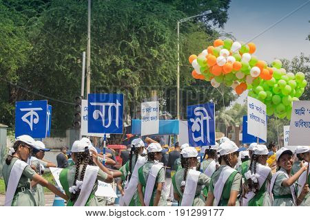 KOLKATA WEST BENGAL / INDIA - AUGUST 15TH 2016 : Young girls carrying placards about