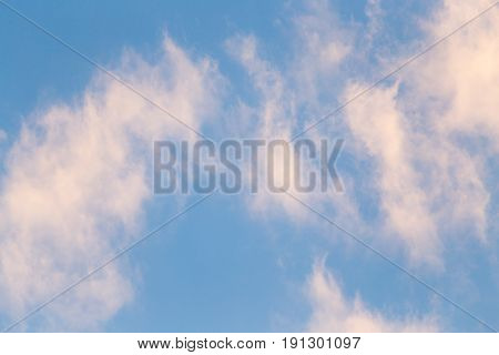 beautiful clouds at sunset as background . A photo