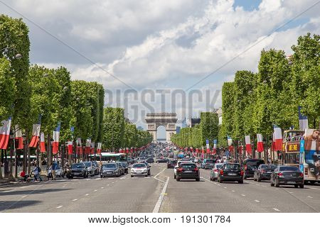 Paris, France - May 13, 2017: View of the famous avenue des Champs Elysees and the Arc de Triomphe