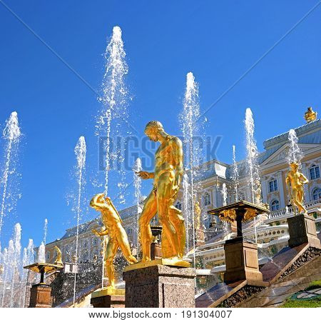 Petergof, Russia - June 5, 2017: Great cascade. It consists of many fountains and is decorated with bronze gilt sculptures. During the holidays, it becomes a stage for costumed performances.