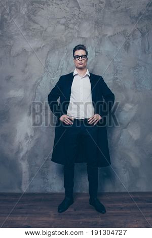 Full Size Portrait Of Young Attractive Businessman. He Is Standing On The Grey Background. So Severe