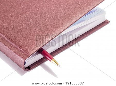 Pen as bookmark in a diary on a white background business style
