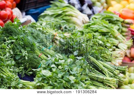 Bundles of parsley and dill at the market.