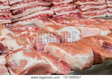 Pieces of fresh pork on the counter in the meat Department of the store