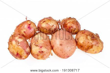 The new potatoes on the white background