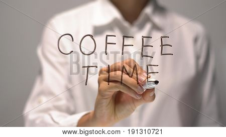 Woman writing Coffee Time on transparent screen. Businesswoman write on board. Businesswoman write on board.