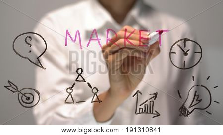 Woman writing Market on transparent screen. Businesswoman write on board. Drawing on desk.