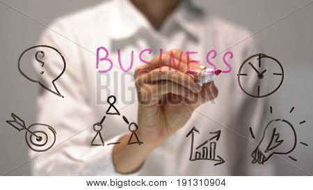 Woman writing Business on transparent screen. Businesswoman write on board. Drawing on desk.