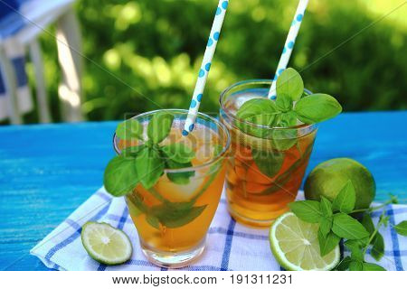 carbonated lemonade with ice, lime and Basil