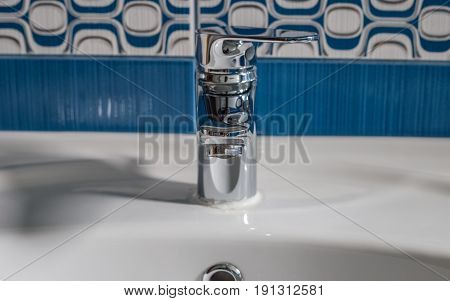 Faucet, Tap, Inner Fountain On The Sink In The Bathroom