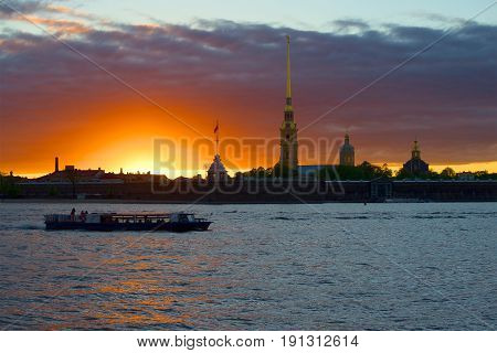 The boat trip on the sunset at the walls of the Peter and Paul fortress, Saint-Petersburg