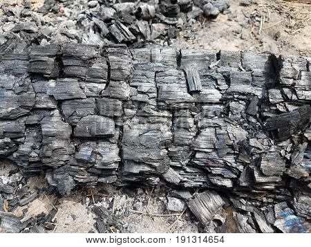 burnt logs and used black charcoal disposed of