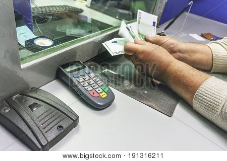Man receives money in a bank, men's hands count the cash notes for 100 euros. Finance concept