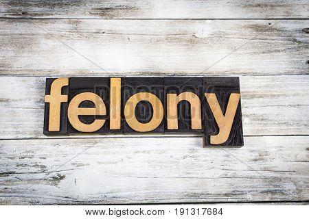 Felony Letterpress Word On Wooden Background