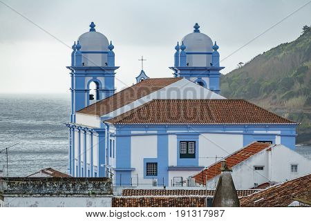 Long shot view of church in Angra do Heroismo with atlantic ocean in the background, Island of Terceira in Azores, Portugal