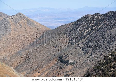 Arid and barren mountains with the Mojave Desert beyond taken in the Southern Sierra Nevada Mountains, CA