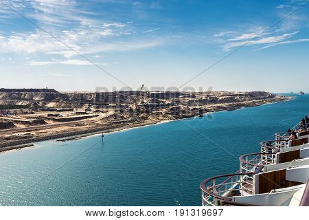 The Suez Canal - a ship convoy with a cruise ship passes the new eastern extension canal opend in August 2015