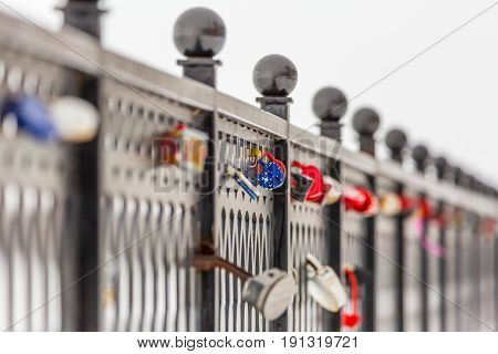 Locks of love and loyalty on the metal fence. The City Of Saratov, Russia. The Volga river embankment. Winter