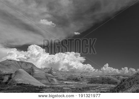 Billowing Clouds At Badlands National Park