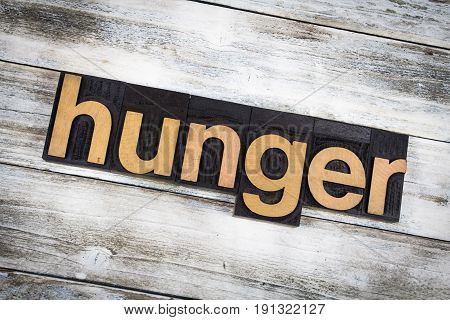 Hunger Letterpress Word On Wooden Background