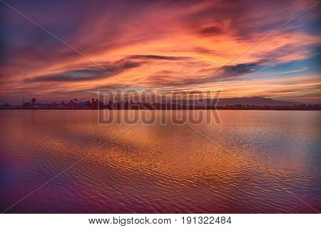 View From Water Of The Sunrise Full Of  Colors