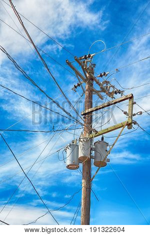 A Electric Pole With Transformer And Wire  The Cloudy Sky