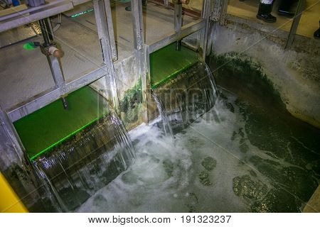 Inside modern wastewater treatment plant. Water purification by ultraviolet