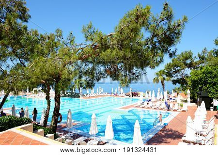 FETHIYE TURKEY - MAY 19: The tourists enjoing their vacation in luxury hotel on May 19 2013 in Fethiye Turkey. More then 36 mln tourists have visited Turkey in year 2013