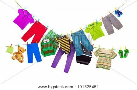 Laundry lines with colorful clothes isolated on white background