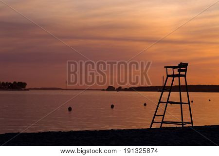 Rescue Tower On The Beach On Sunset Background