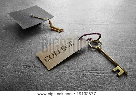 Mini graduation cap and key with College tag