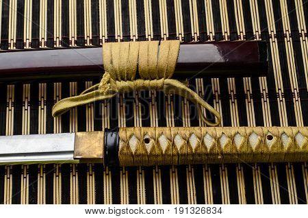 Japanese Sword Katana On Bamboo Mat