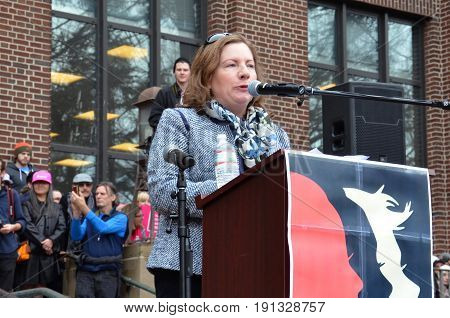 ANN ARBOR MI - JAN 21: Vice Chair of the Washtenaw County Board of Commissioners Michelle Regalado Deatrick addresses the Women's March in Ann Arbor on January 21 2017.