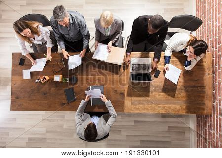 Diverse Business Team At Workplace In Meeting