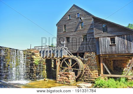A riverbed view of Yates Millpond watermill in Raleigh North Carolina.