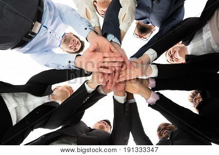Low Angle View Of Multiracial People Stacking Hands