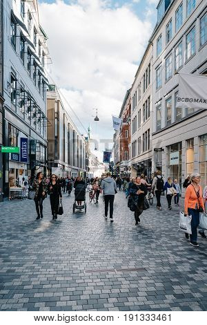 Copenhagen Denmark - August 11 2016. Stroget Street. People walking on commercial street with luxury retail shops in historical city centre of Copenhagen a sunny day of summer