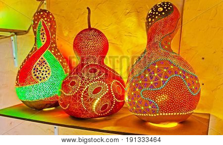 ANTALYA TURKEY - MAY 6 2017: The lamps and shades of dried pumpkin shells are the interesting souvenirs and unusual design detail for interior on May 6 in Antalya.