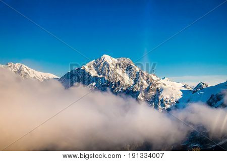 A Wide Panorama of Snowy Mountains with some clouds around, Southern Alps located in south island, in New Zealand.