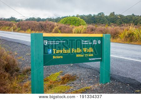 SOUTH ISLAND, NEW ZEALAND - MAY 19, 2017: An informative wooden sign of Tawhai Falls in Tongariro National Park, on the south island, New Zealand.