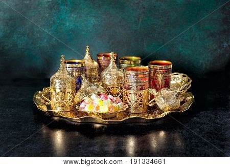 Oriental hospitality. Ramadan kareem. Tea table with golden glasses
