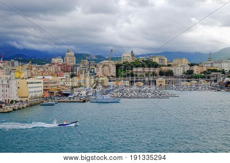 View on the port of Genoa with colorful buildings and boats in Liguria Italy.