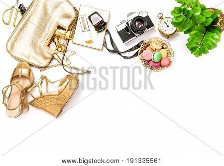 Flat lay for social media fashion bloggers. Feminine accessories bag shoes vintage no name photo camera on white background